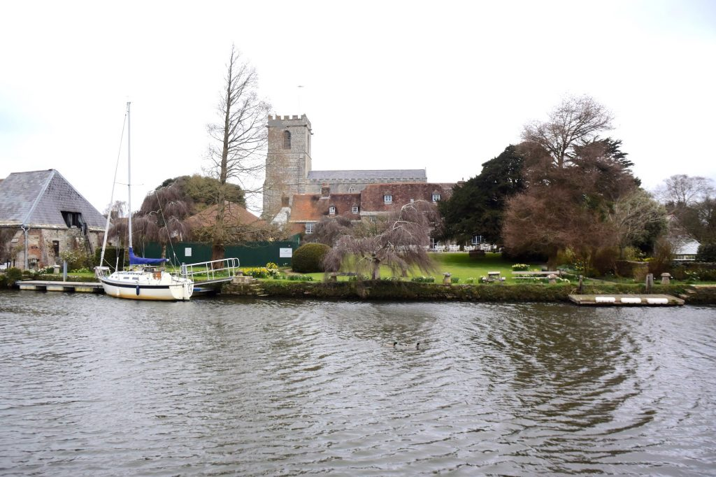 Wareham, the Purbecks, Dorset. A view of Lady St Mary's church from the south bank of the River Frome. Was this the heart of early to middle Saxon Wareham?