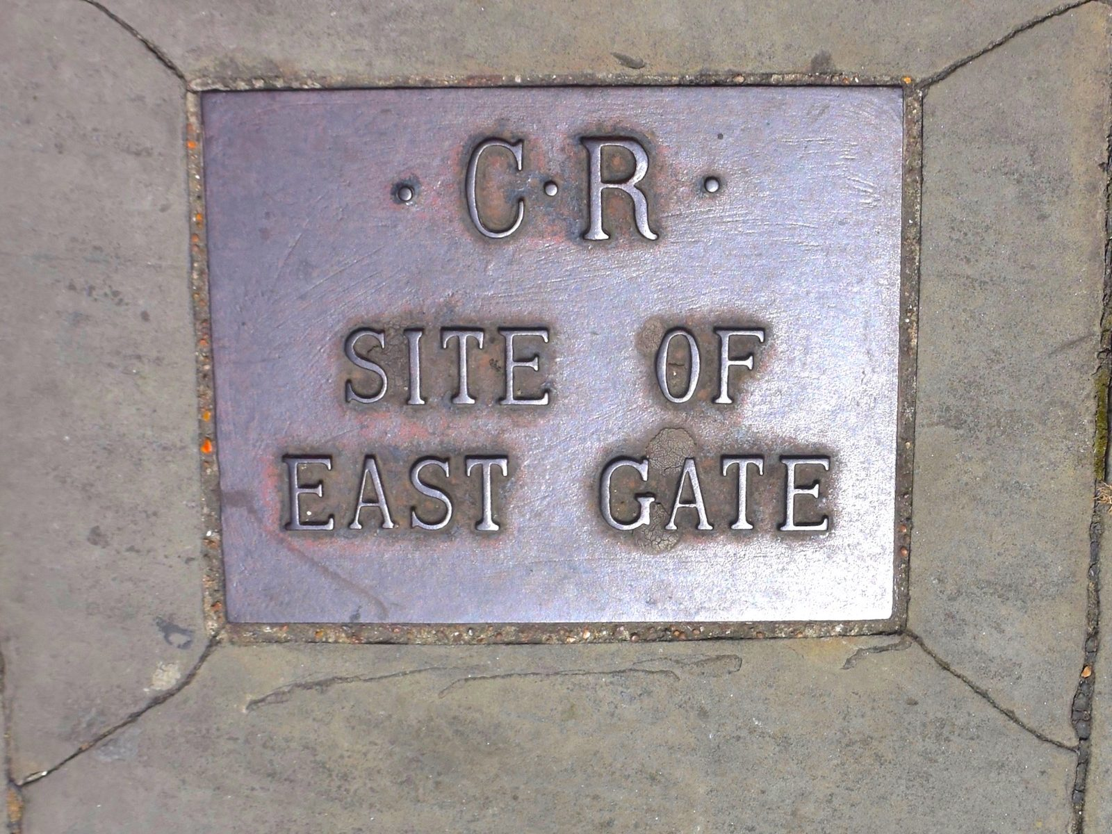 Rochester, Kent. Plaque showing where the East Gate in the Roman walls once was.