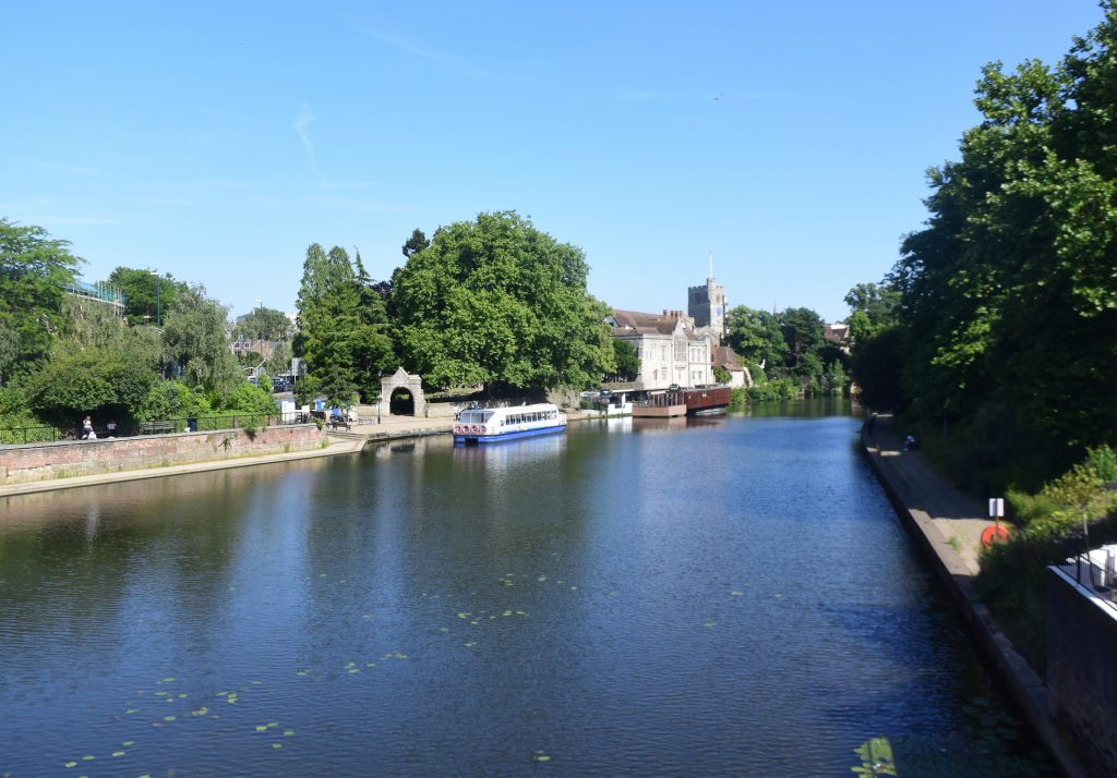 The River Medway at Maidstone, Kent. Looking south from Maidstone Bridge, with the Archbishop's Palace and All Saints' Church in the distance to the left
