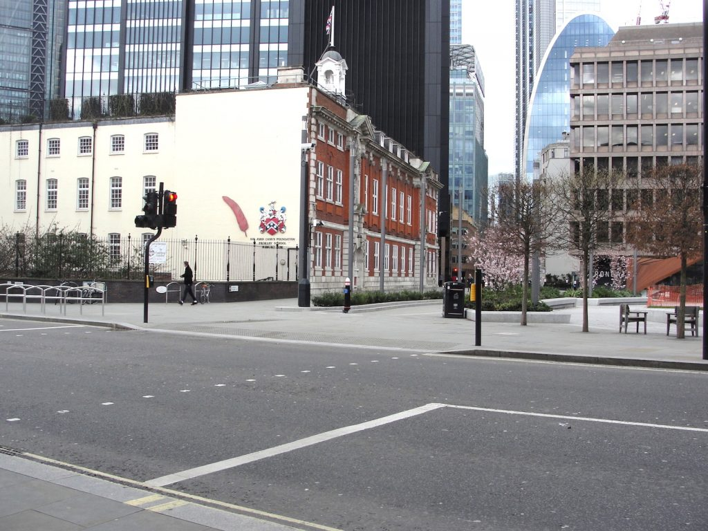 Where the Aldgate, one of the gates through the Roman walls of London, would have once stood.