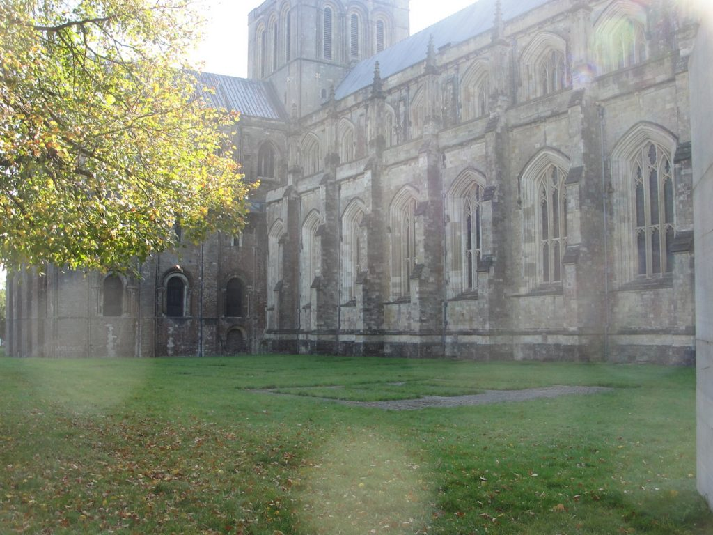 The outline of the Old Minster in the lawn adjacent to Winchester Cathedral, Hampshire