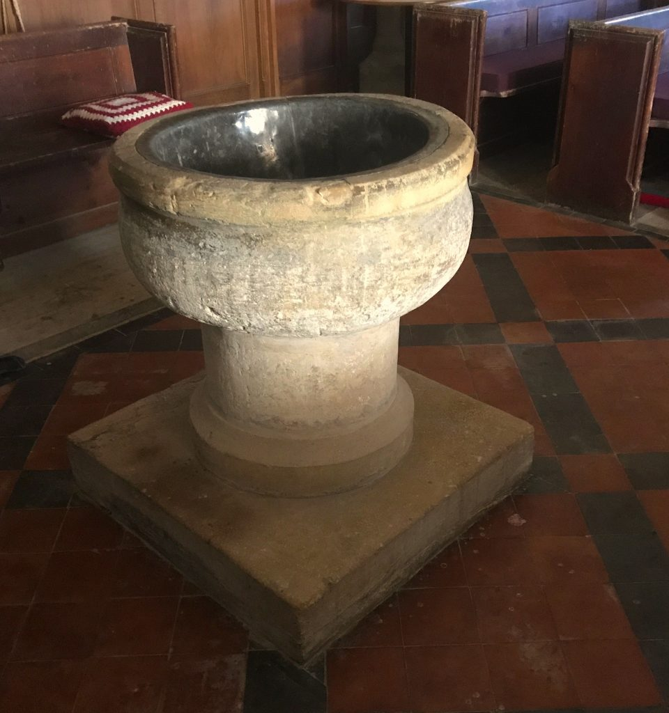 The older of the two fonts at St Andrew's church, Aller, Somerset Levels