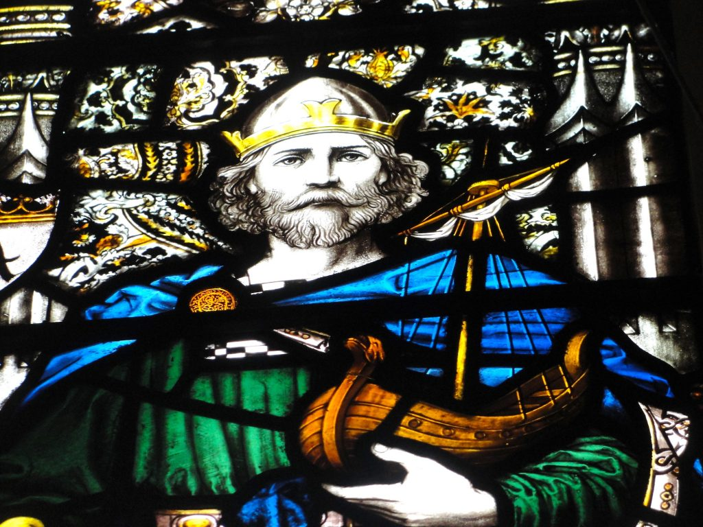 King Alfred stained glass window at St John the Baptist church, Busbridge, near Godalming, Surrey