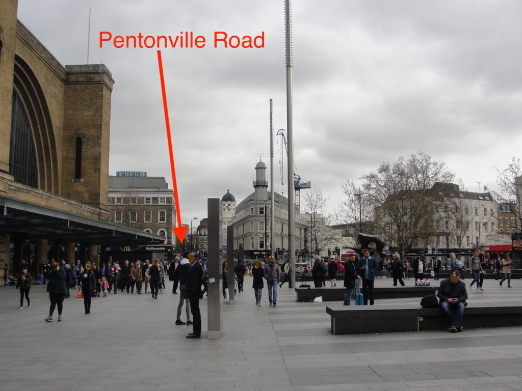 After King's Cross train station, the course of the River Fleet heads down Pentonville Road until it meets with King's Cross Road. This photo shows which road is Pentonville Road, and therefore the former course of the river must head in this direction. The photo is taken looking east, with King's Cross just visible on the left.