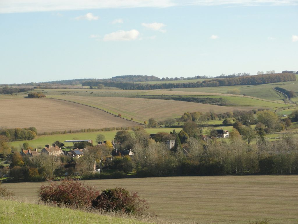 Looking back to Kingston Deverill, Wiltshire, from the climb up to Cold Kitchen Hill