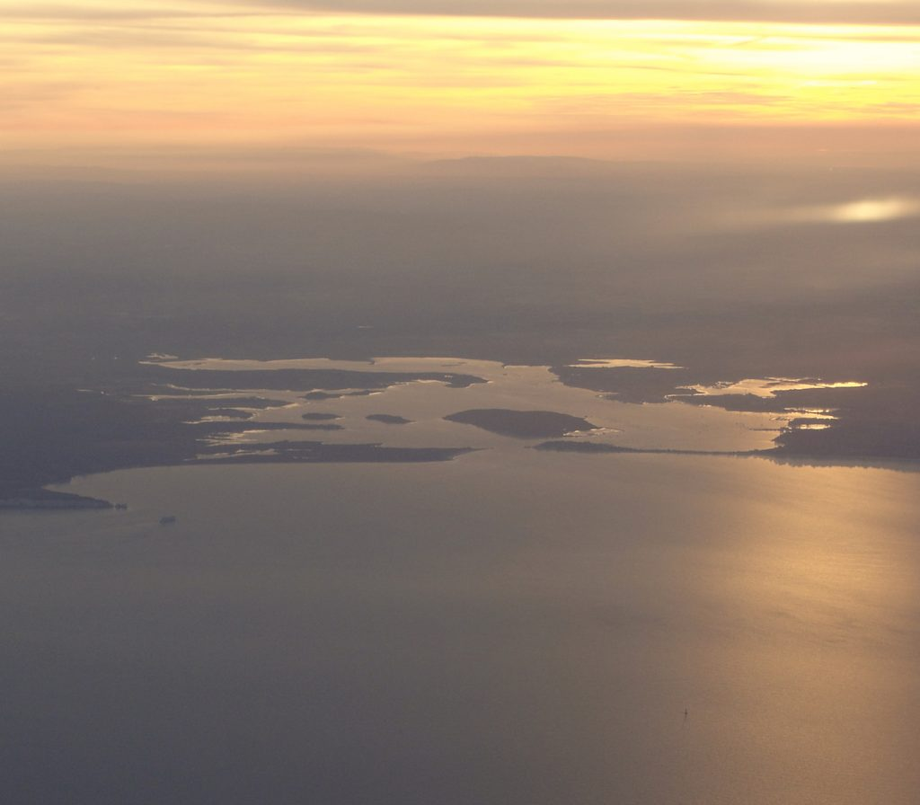 Poole Harbour, Dorset, taken from an aeroplane at dusk