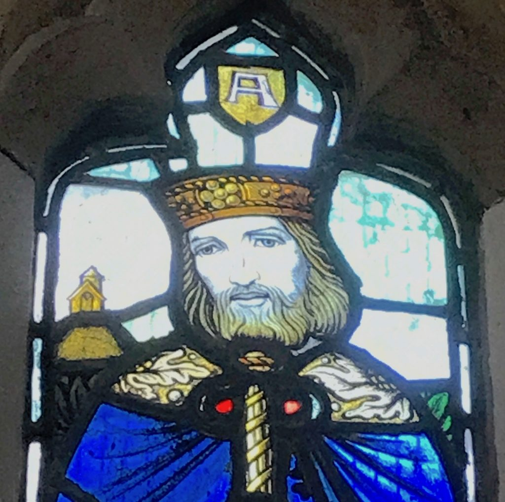 King Alfred in a stained glass window in St Andrew's church, Aller, Somerset