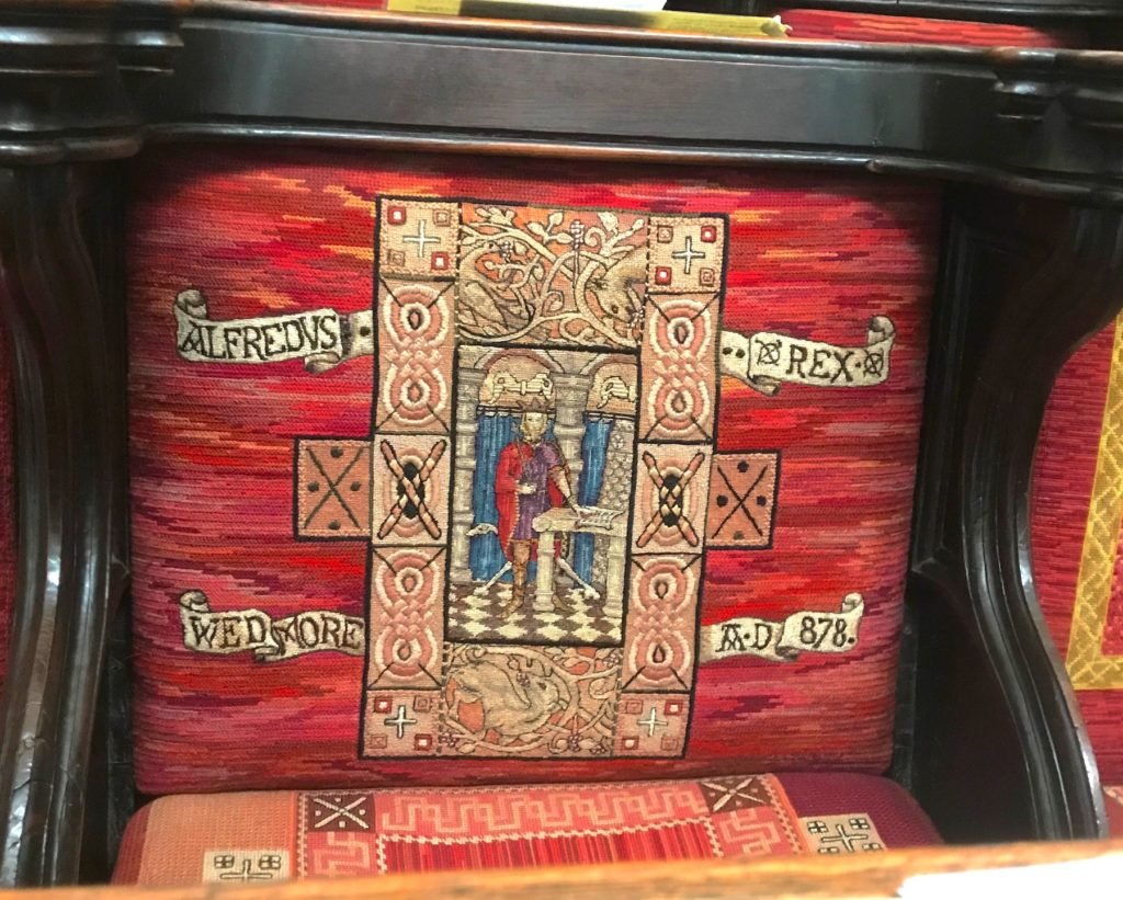 Wells Cathedral, Somerset. Seat cover commemorating King Alfred's presence at Wedmore in 878