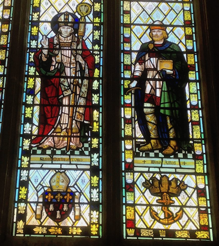 Wells cathedral, Somerset. Stained glass window showing King Alfred the Great. St Martin of Tours is shown to the left