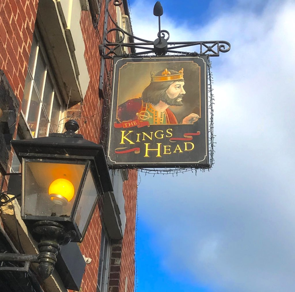 Wells, Somerset. A sign of a pub called The King's Head.