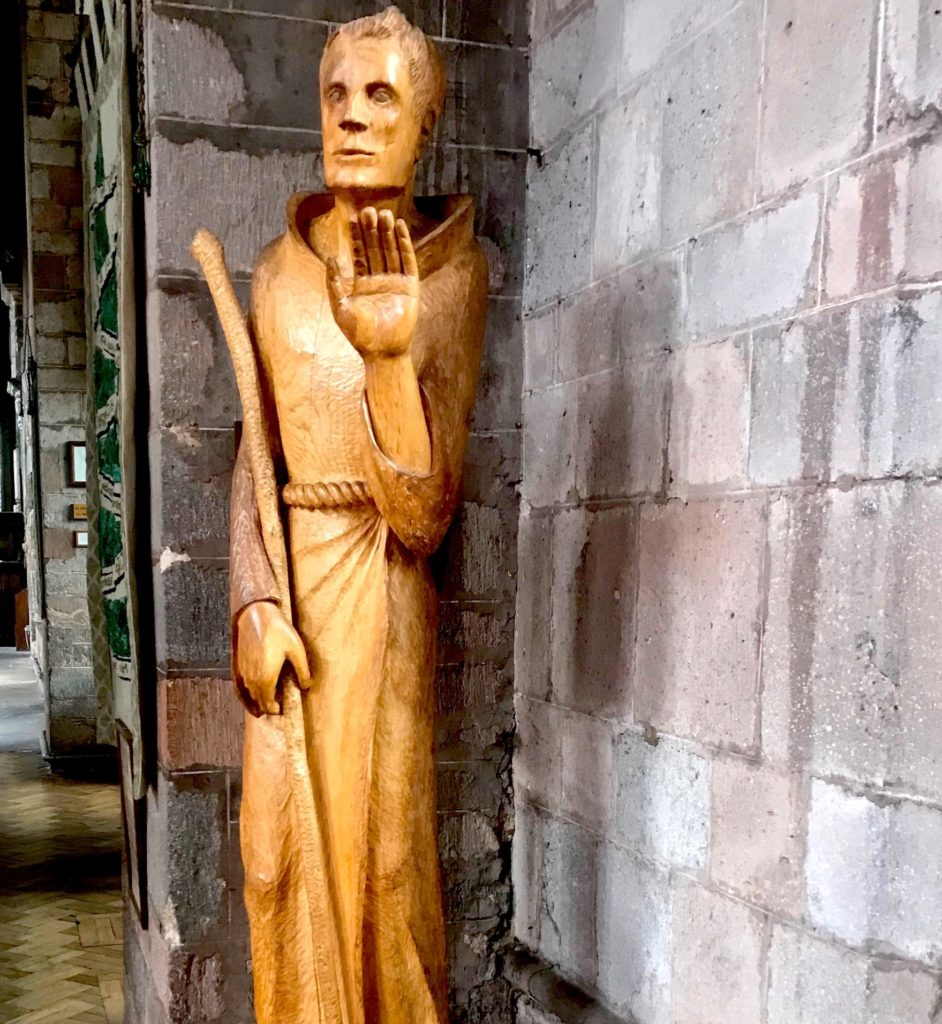 A wood carving of St Boniface inside Crediton parish church