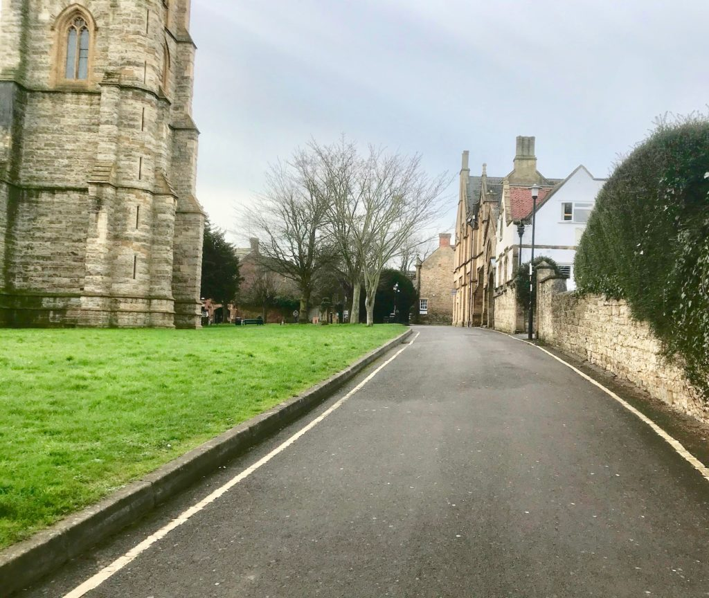 Church path, to the west of St John the Baptist church in Yeovil, Somerset. Looking south.